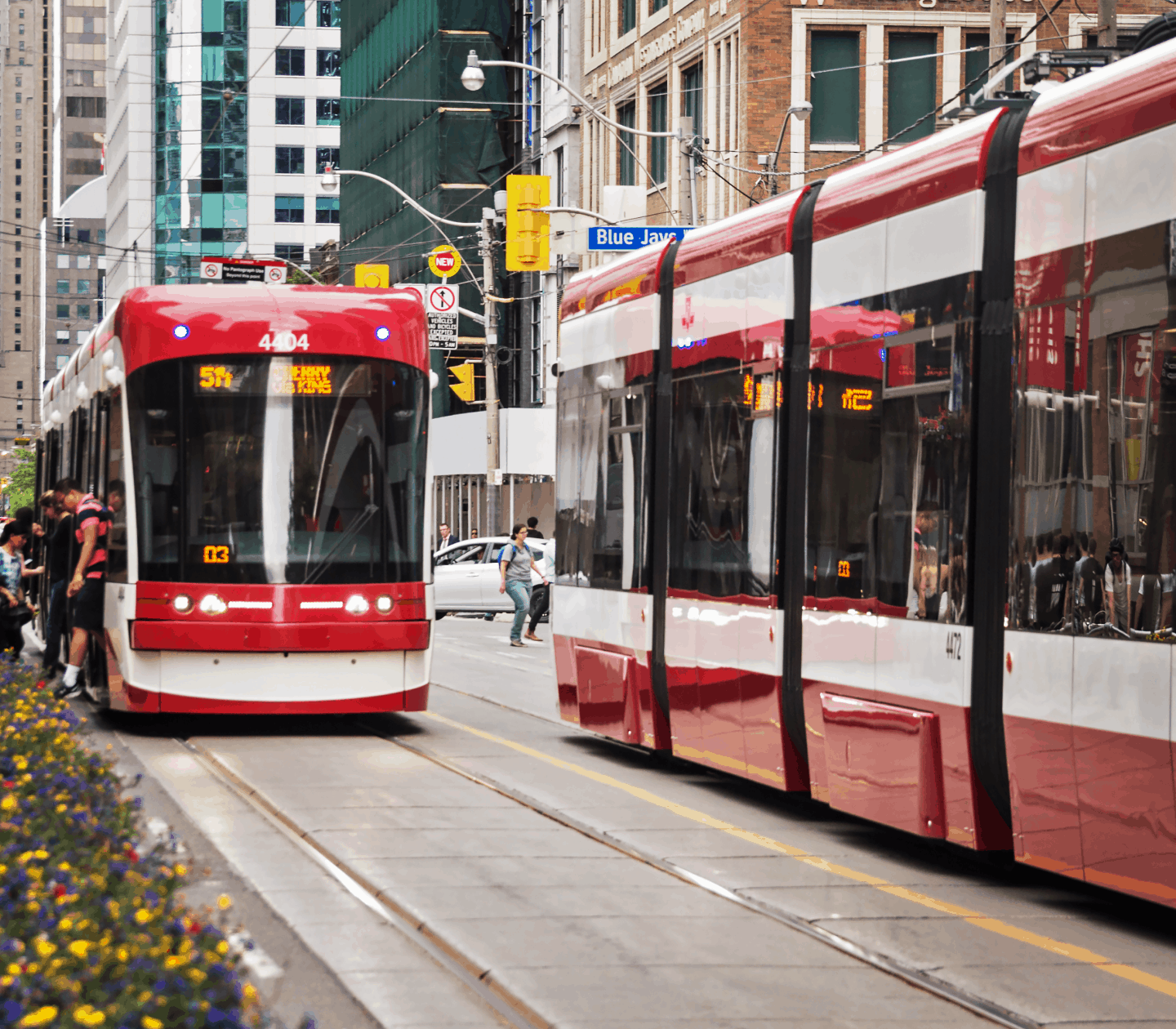 A TTC streetcar making a stop in downtown Toronto